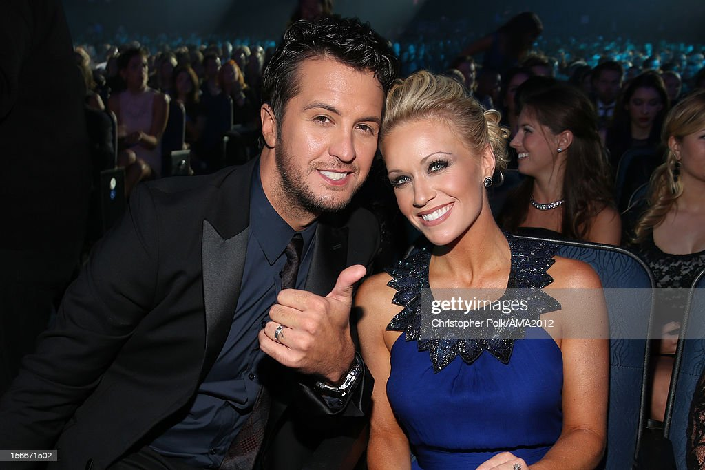 Singer <a gi-track='captionPersonalityLinkClicked' href=/galleries/search?phrase=Luke+Bryan&family=editorial&specificpeople=4001956 ng-click='$event.stopPropagation()'>Luke Bryan</a> and Caroline Bryan pose in the audience at the 40th American Music Awards held at Nokia Theatre L.A. Live on November 18, 2012 in Los Angeles, California.