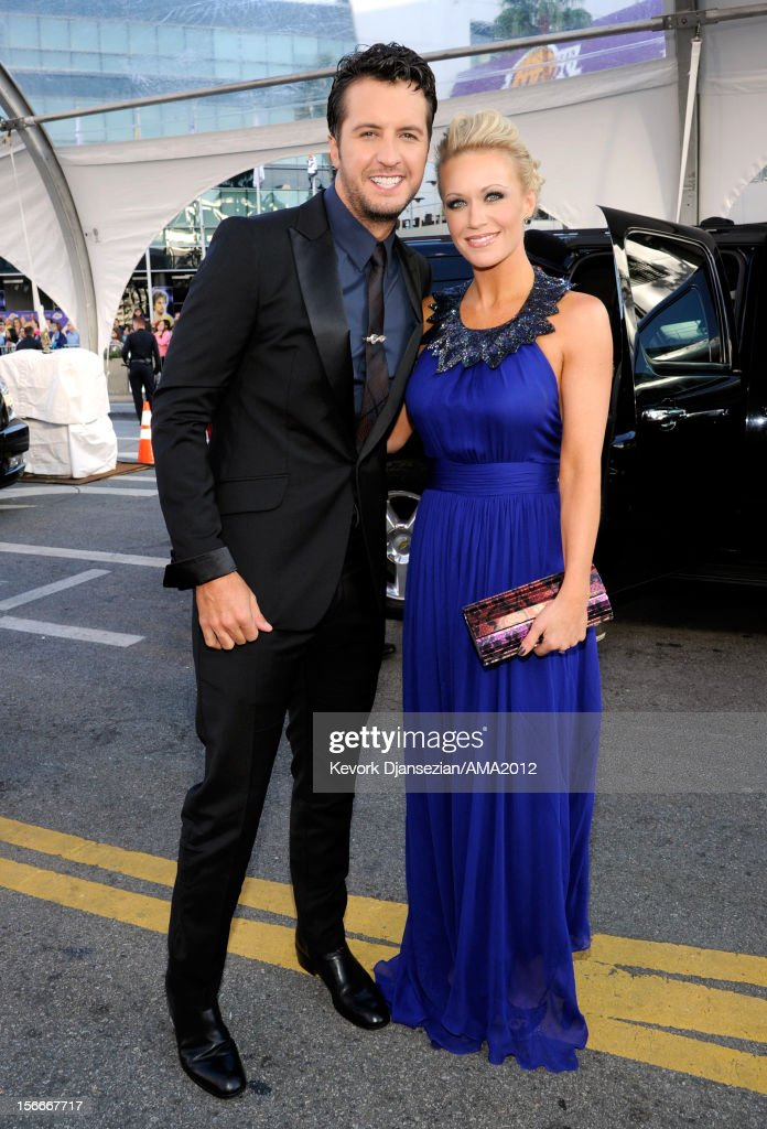 Singer <a gi-track='captionPersonalityLinkClicked' href=/galleries/search?phrase=Luke+Bryan&family=editorial&specificpeople=4001956 ng-click='$event.stopPropagation()'>Luke Bryan</a> and wife Caroline attend the 40th American Music Awards held at Nokia Theatre L.A. Live on November 18, 2012 in Los Angeles, California.