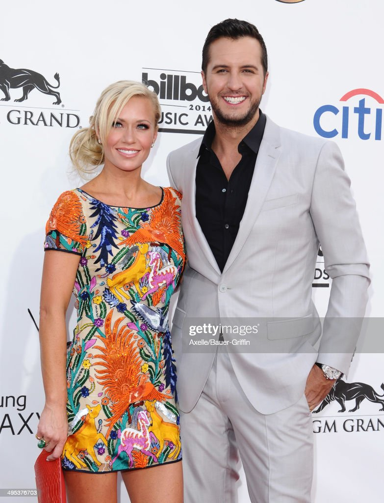 Singer Luke Bryan and wife Caroline Boyer arrive at the 2014 Billboard Music Awards at the MGM Grand Garden Arena on May 18, 2014 in Las Vegas, Nevada.