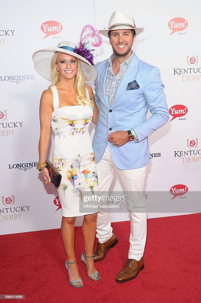 Singer Luke Bryan (R) and wife Caroline Boyer attend the 139th Kentucky Derby at Churchill Downs on May 4, 2013 in Louisville, Kentucky.