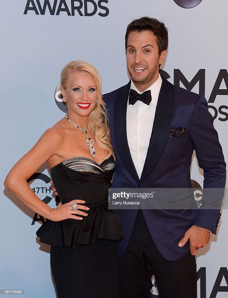 Singer <a gi-track='captionPersonalityLinkClicked' href=/galleries/search?phrase=Luke+Bryan&family=editorial&specificpeople=4001956 ng-click='$event.stopPropagation()'>Luke Bryan</a> (R) and wife Caroline Boyer attends the 47th annual CMA Awards at the Bridgestone Arena on November 6, 2013 in Nashville, Tennessee.