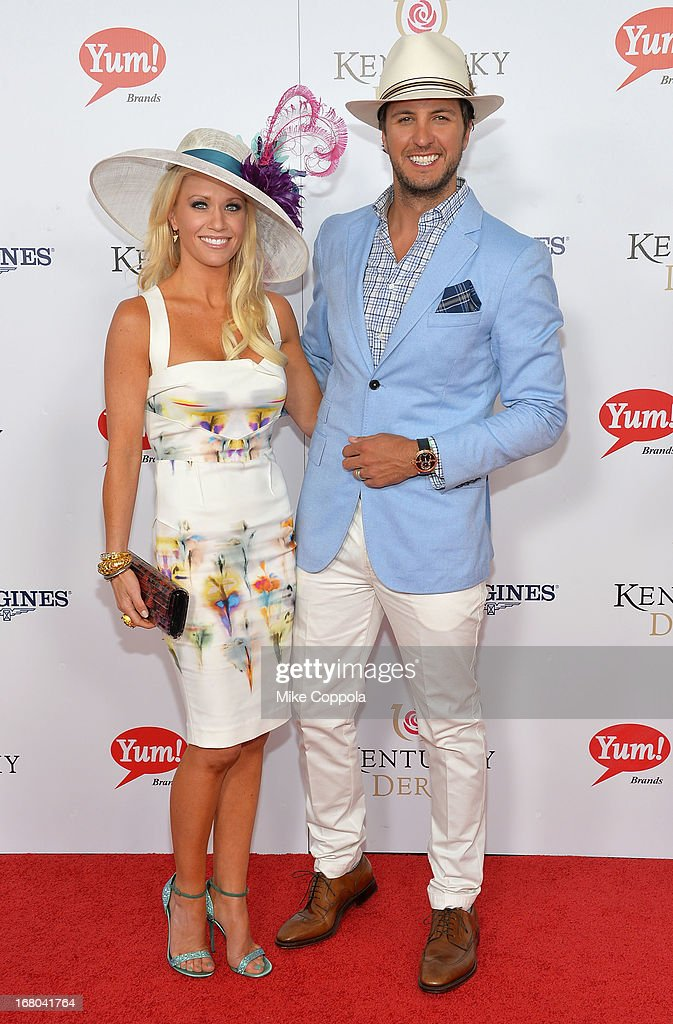 Singer Luke Bryan (R) and wife Caroline Boyer celebrate the 139th Kentucky Derby with Moet & Chandon at Churchill Downs on May 4, 2013 in Louisville, Kentucky.