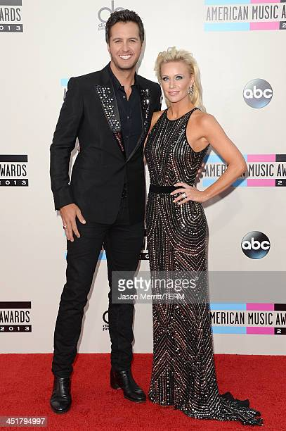 Singer Luke Bryan and wife Caroline Bryan attend the 2013 American Music Awards at Nokia Theatre LA Live on November 24 2013 in Los Angeles California