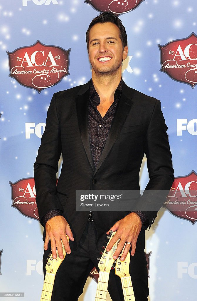 Singer <a gi-track='captionPersonalityLinkClicked' href=/galleries/search?phrase=Luke+Bryan&family=editorial&specificpeople=4001956 ng-click='$event.stopPropagation()'>Luke Bryan</a> poses in th press room during the American Country Awards 2013 at the Mandalay Bay Events Center on December 10, 2013 in Las Vegas, Nevada.