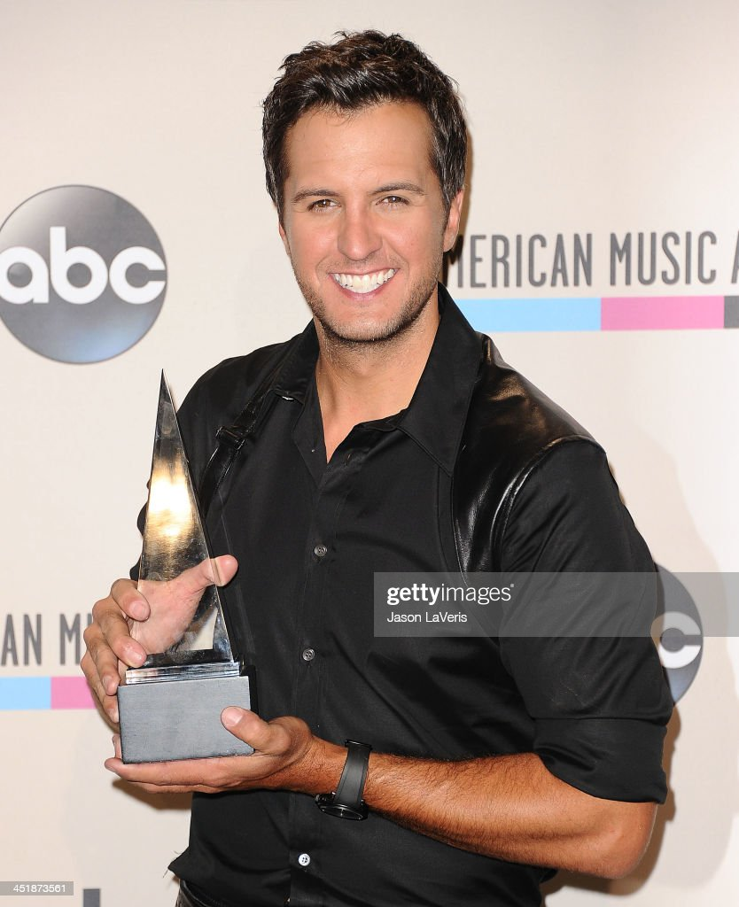 Singer <a gi-track='captionPersonalityLinkClicked' href=/galleries/search?phrase=Luke+Bryan&family=editorial&specificpeople=4001956 ng-click='$event.stopPropagation()'>Luke Bryan</a> poses in the press room at the 2013 American Music Awards at Nokia Theatre L.A. Live on November 24, 2013 in Los Angeles, California.
