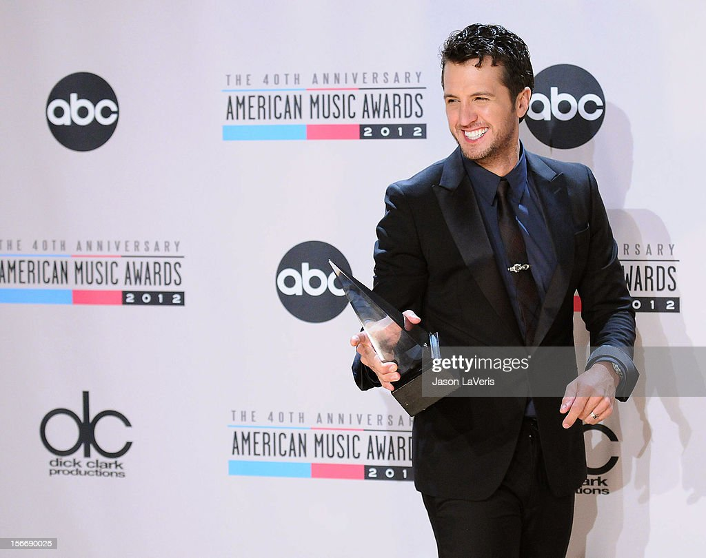 Singer <a gi-track='captionPersonalityLinkClicked' href=/galleries/search?phrase=Luke+Bryan&family=editorial&specificpeople=4001956 ng-click='$event.stopPropagation()'>Luke Bryan</a> poses in the press room at the 40th American Music Awards at Nokia Theatre L.A. Live on November 18, 2012 in Los Angeles, California.