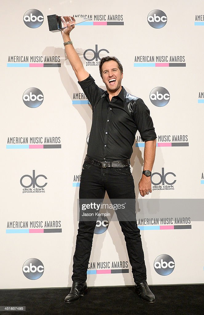 Singer <a gi-track='captionPersonalityLinkClicked' href=/galleries/search?phrase=Luke+Bryan&family=editorial&specificpeople=4001956 ng-click='$event.stopPropagation()'>Luke Bryan</a>, winner of the Favorite Country Male Artist award, poses in the press room during the 2013 American Music Awards at Nokia Theatre L.A. Live on November 24, 2013 in Los Angeles, California.