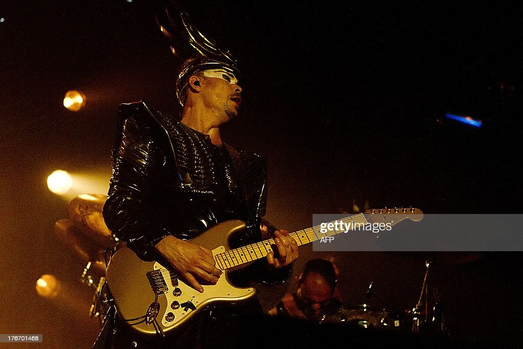 Singer Luke Steele of the band 'Empire of the Sun' performs on stage during the second day of the Lowlands festival in Biddinghuizen, on August 17, 2013. The music festival runs from August 16 to 18, 2013.