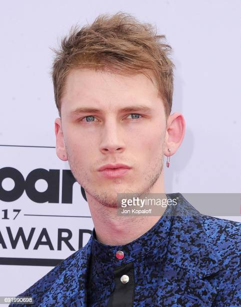Singer Machine Gun Kelly arrives at the 2017 Billboard Music Awards at TMobile Arena on May 21 2017 in Las Vegas Nevada