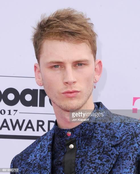Singer Machine Gun Kelly arrives at the 2017 Billboard Music Awards at TMobile Arena on May 21 2017 in Las Vegas Nevada
