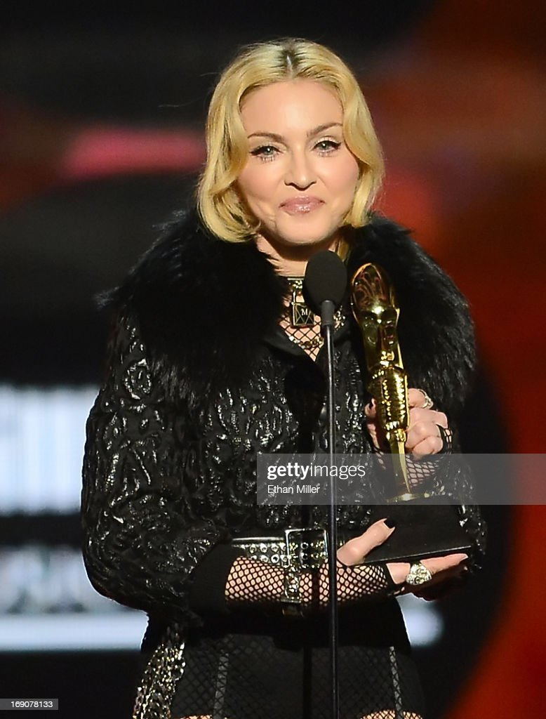 Singer Madonna accepts the award for Top Touring Artist onstage during the 2013 Billboard Music Awards at the MGM Grand Garden Arena on May 19, 2013 in Las Vegas, Nevada.