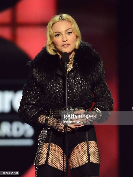 Singer Madonna accepts the award for Touring Artist of the Year onstage during the 2013 Billboard Music Awards at the MGM Grand Garden Arena on May...
