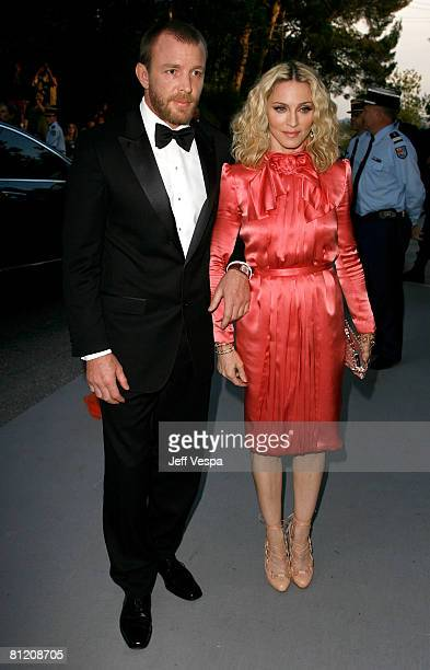 Singer Madonna and director Guy Richie arrives at amfAR's Cinema Against AIDS 2008 benefit held at Le Moulin de Mougins during the 61st International...