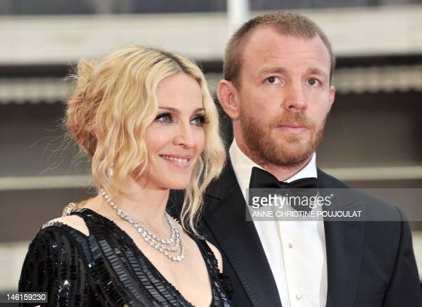 US singer Madonna and her husband British director Guy Ritchie pose as they arrive to attend the screening of Nathan Rissman's film 'I Am Beacuse We...