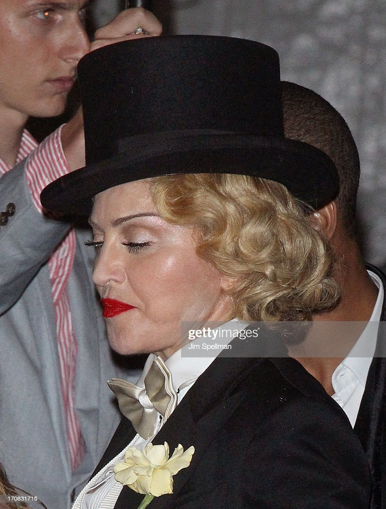 Singer Madonna (hair detail) attends the Dolce & Gabbana and The Cinema Society screening of the Epix World premiere of 'Madonna: The MDNA Tour' at The Paris Theatre on June 18, 2013 in New York City.