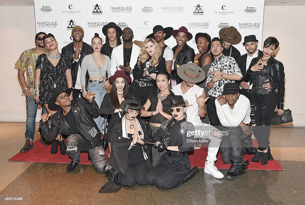 Singer Madonna (C) is surrounded by her dancers as they arrive at the Marquee Nightclub at The Cosmopolitan of Las Vegas to host an after party for their Rebel Heart Tour concert stop on October 25, 2015 in Las Vegas, Nevada.