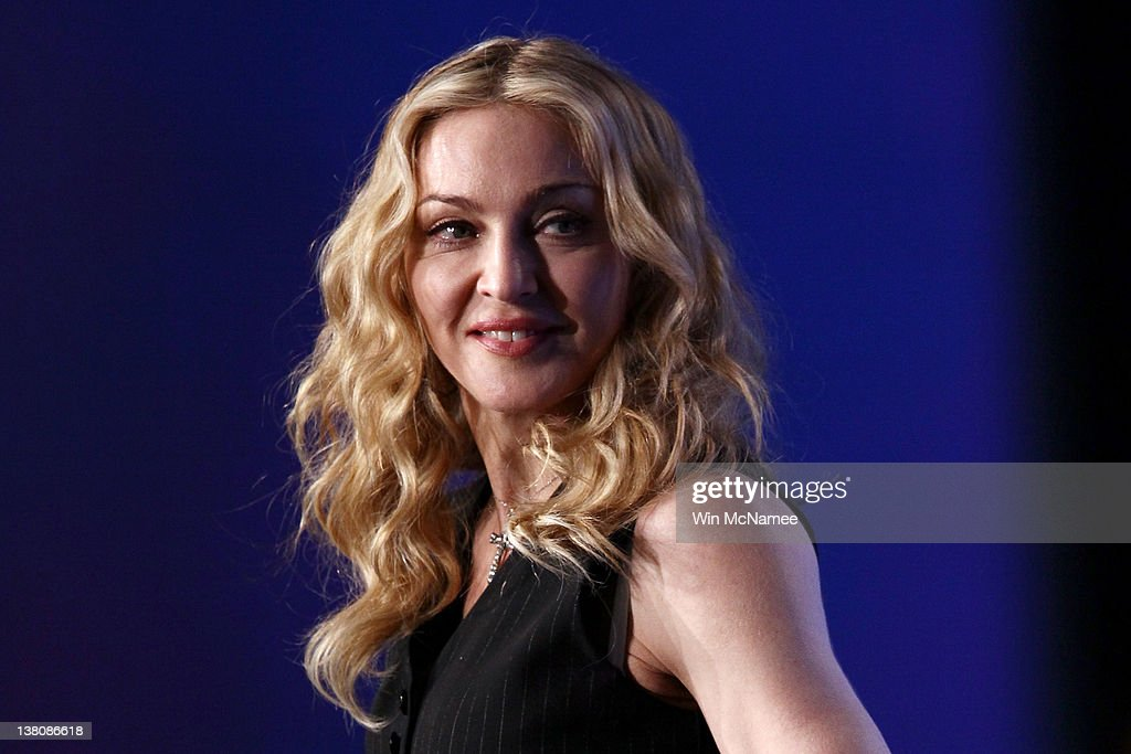 Singer Madonna looks on on during a press conference for the Bridgestone Super Bowl XLVI halftime show at the Super Bowl XLVI Media Center in the J.W. Marriott Indianapolis on February 2, 2012 in Indianapolis, Indiana.
