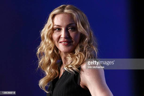 Singer Madonna looks on on during a press conference for the Bridgestone Super Bowl XLVI halftime show at the Super Bowl XLVI Media Center in the JW...