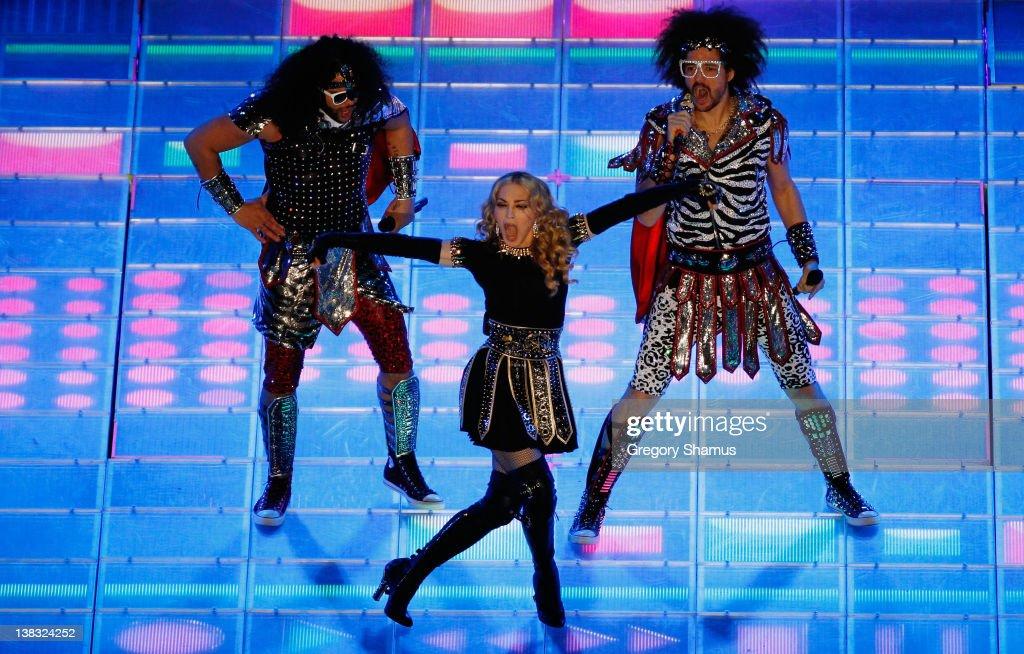 Singer Madonna performs alongside LMFAO during the Bridgestone Super Bowl XLVI Halftime Show at Lucas Oil Stadium on February 5 2012 in Indianapolis...