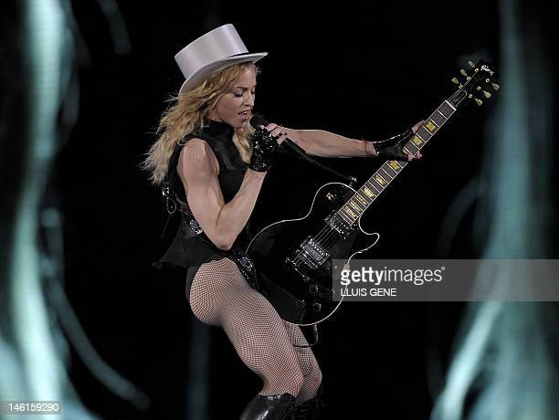 US singer Madonna performs during her 'Sticky Sweet Tour' concert on July 21 2009 at the Olympic Stadium 'Lluis Companys' in Barcelona AFP PHOTO/...
