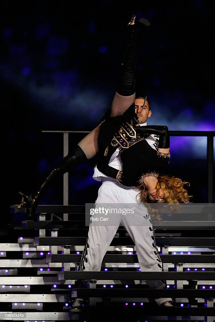 Singer <a gi-track='captionPersonalityLinkClicked' href=/galleries/search?phrase=Madonna+-+Singer&family=editorial&specificpeople=156408 ng-click='$event.stopPropagation()'>Madonna</a> performs during the Bridgestone Super Bowl XLVI Halftime Show at Lucas Oil Stadium on February 5, 2012 in Indianapolis, Indiana.