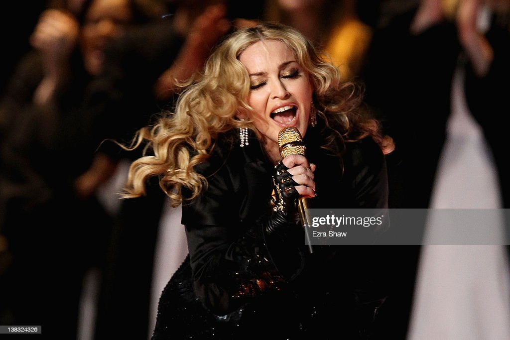 Singer Madonna performs during the Bridgestone Super Bowl XLVI Halftime Show at Lucas Oil Stadium on February 5 2012 in Indianapolis Indiana