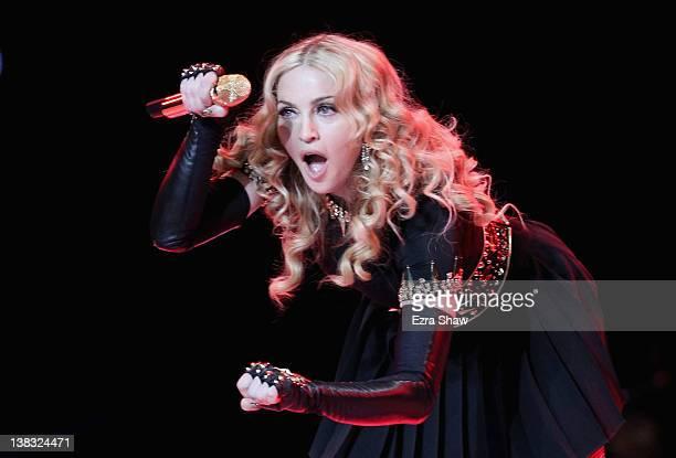 Singer Madonna performs during the Bridgestone Super Bowl XLVI Halftime Show at Lucas Oil Stadium on February 5 2012 in Indianapolis Indiana
