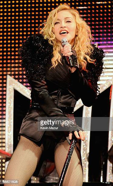 Singer Madonna performs onstage during the opening night of her 'Sticky and Sweet' tour at the O2 Arena on July 4 2009 in London England
