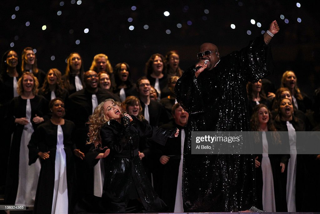 Singer <a gi-track='captionPersonalityLinkClicked' href=/galleries/search?phrase=Madonna+-+Singer&family=editorial&specificpeople=156408 ng-click='$event.stopPropagation()'>Madonna</a> (L) performs with Cee Lo Green during the Bridgestone Super Bowl XLVI Halftime Show at Lucas Oil Stadium on February 5, 2012 in Indianapolis, Indiana.