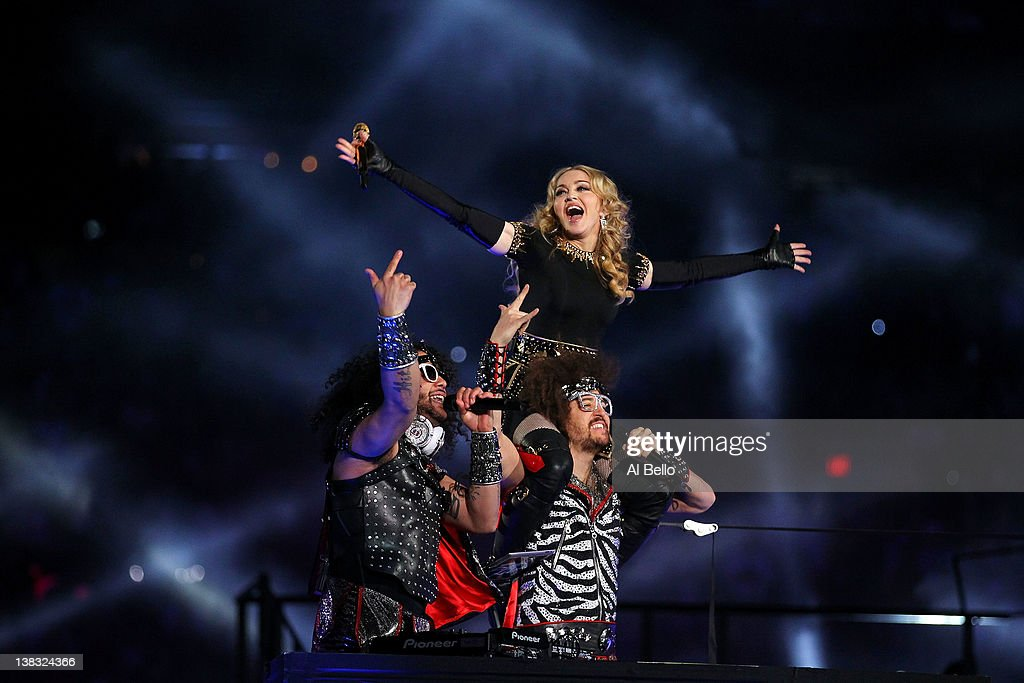 Singer <a gi-track='captionPersonalityLinkClicked' href=/galleries/search?phrase=Madonna+-+S%C3%A5ngerska&family=editorial&specificpeople=156408 ng-click='$event.stopPropagation()'>Madonna</a> performs with <a gi-track='captionPersonalityLinkClicked' href=/galleries/search?phrase=Redfoo&family=editorial&specificpeople=5857552 ng-click='$event.stopPropagation()'>Redfoo</a> and SkyBlu of LMFAO during the Bridgestone Super Bowl XLVI Halftime Show at Lucas Oil Stadium on February 5, 2012 in Indianapolis, Indiana.