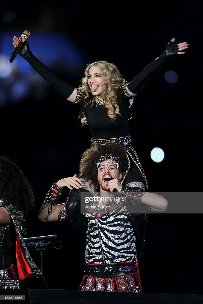 Singer <a gi-track='captionPersonalityLinkClicked' href=/galleries/search?phrase=Madonna+-+S%C3%A5ngerska&family=editorial&specificpeople=156408 ng-click='$event.stopPropagation()'>Madonna</a> performs with <a gi-track='captionPersonalityLinkClicked' href=/galleries/search?phrase=Redfoo&family=editorial&specificpeople=5857552 ng-click='$event.stopPropagation()'>Redfoo</a> of LMFAO during the Bridgestone Super Bowl XLVI Halftime Show at Lucas Oil Stadium on February 5, 2012 in Indianapolis, Indiana.