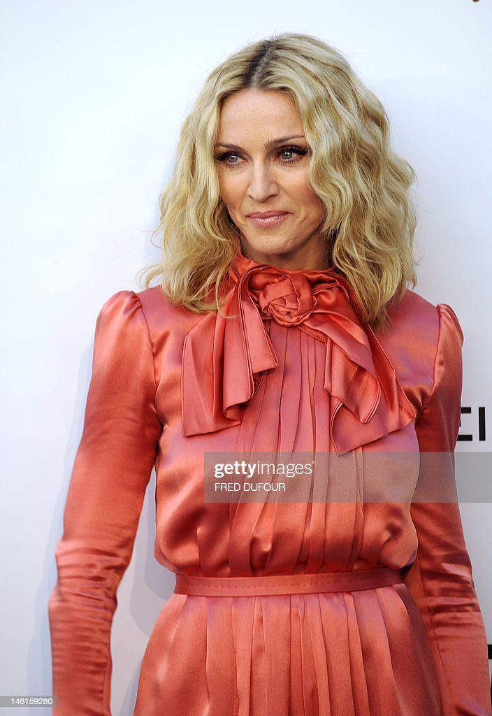 US singer Madonna poses as she arrives to attend the amfAR's Cinema Against AIDS 2008 benefit at Le Moulin de Mougins during the 61st International...