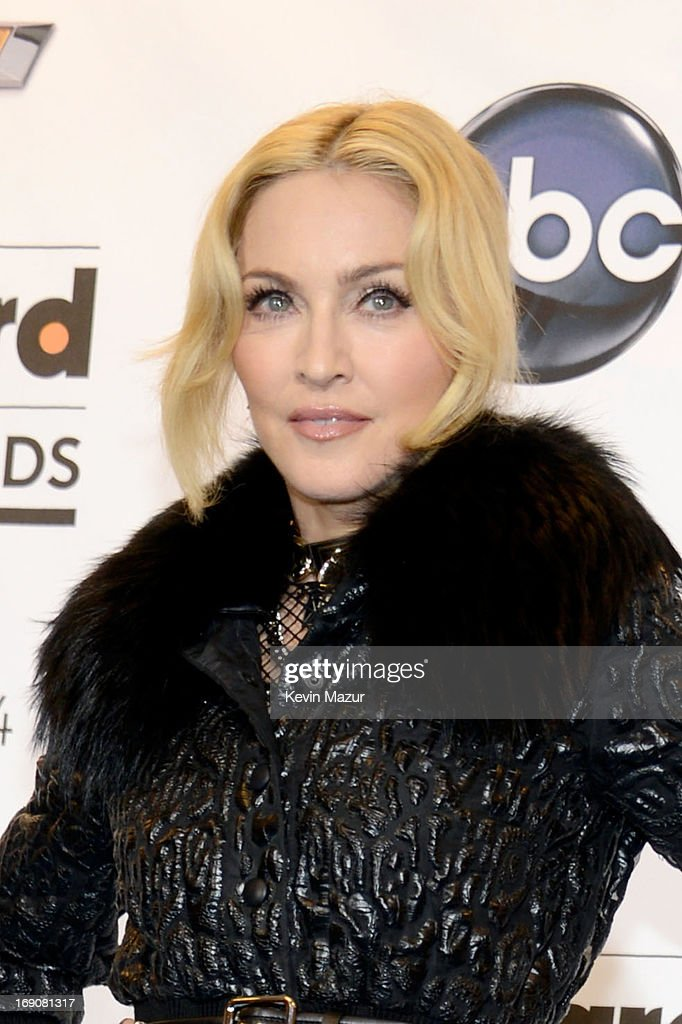 Singer Madonna poses in the press room during the 2013 Billboard Music Awards at the MGM Grand Garden Arena on May 19, 2013 in Las Vegas, Nevada.