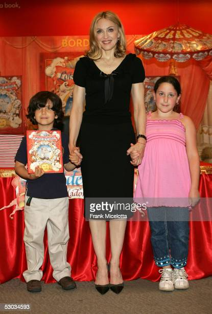 Singer Madonna poses with children from Public School 191 after reading her latest children's book 'Lotsa de Casha' at Borders Bookstore June 7 2005...