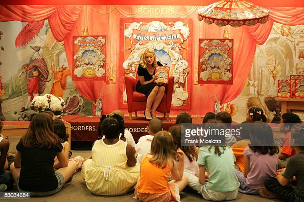 Singer Madonna reads her latest children's book 'Lotsa de Casha' to children from Public School 191 at Borders Bookstore June 7 2005 in New York City...