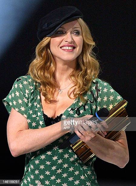 US singer Madonna receives an award during the NRJ awards ceremony Saturday Jan 24 in Cannes southern France AFP PHOTOBruno BebertPOOL