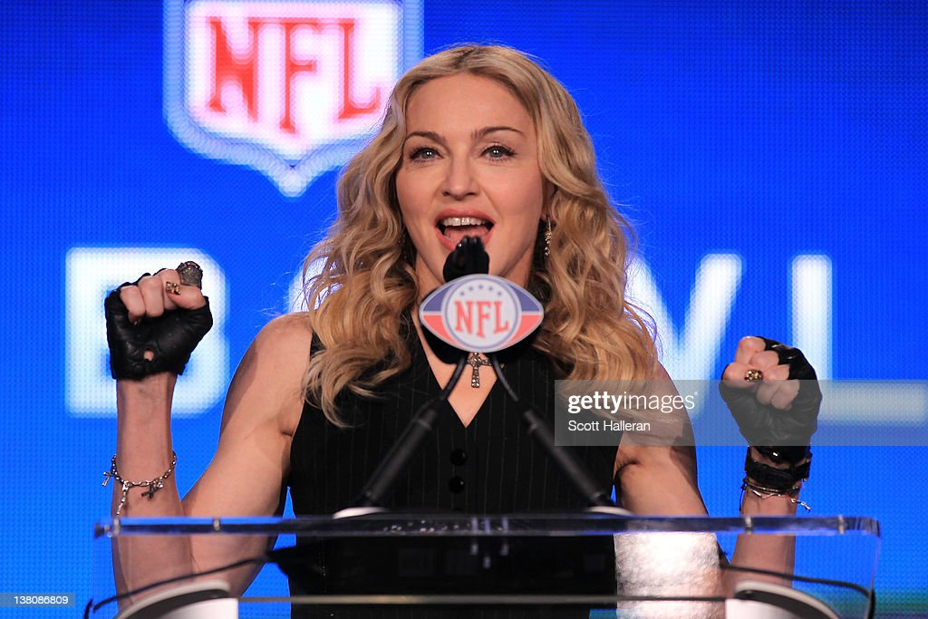 Singer Madonna speaks at the podium during a press conference for the Bridgestone Super Bowl XLVI halftime show at the Super Bowl XLVI Media Center in the J.W. Marriott Indianapolis on February 2, 2012 in Indianapolis, Indiana.