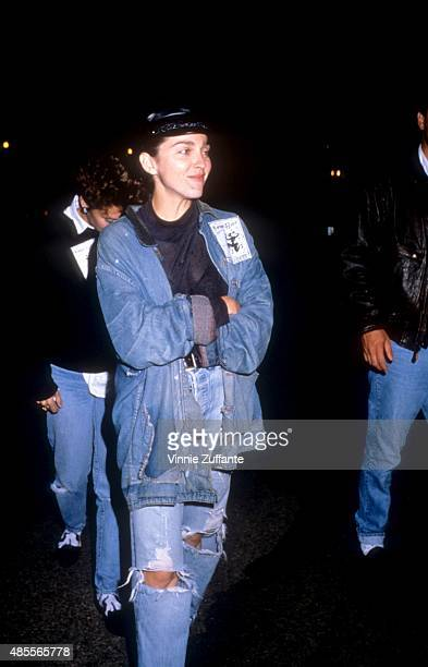 Singer Madonna walks in the street wearing waist high blue jeans and a jean jacket in November 1988 in New York New York