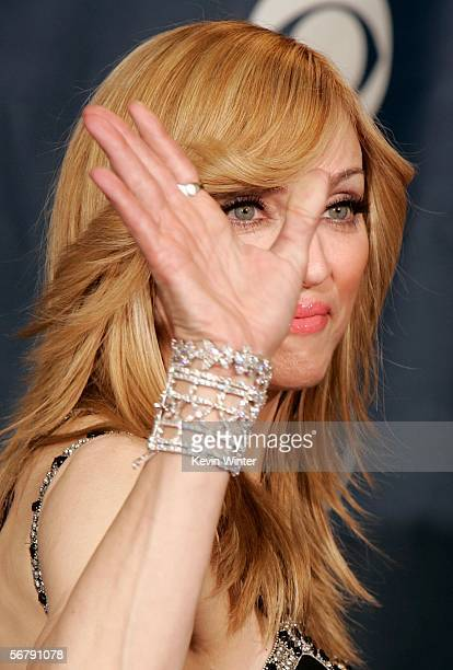 Singer Madonna waves goodbye in the press room at the 48th Annual Grammy Awards at the Staples Center on February 8 2006 in Los Angeles California