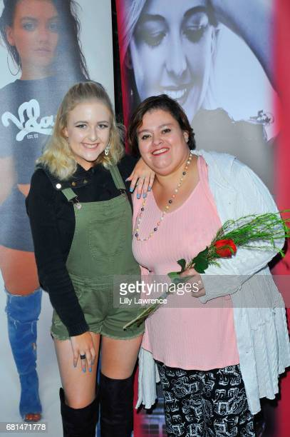 Singer Mahkenna with Virginia Arlene at Mother's Day Night Out Concert at Surf City Nights on May 9 2017 in Huntington Beach California