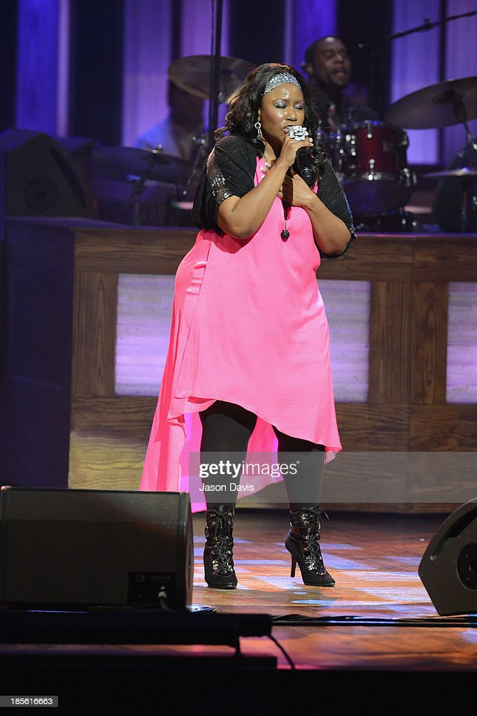 Singer Mandisa performs during the 5th annual Opry Goes Pink show at The Grand Ole Opry on October 22, 2013 in Nashville, Tennessee.