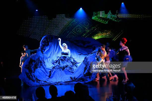 Singer Manon from 'The Voice' TV Show Charlene Klemm and Dancers perform on stage during the 'Paris Merveilles' Lido New Revue Opening Gala on April...
