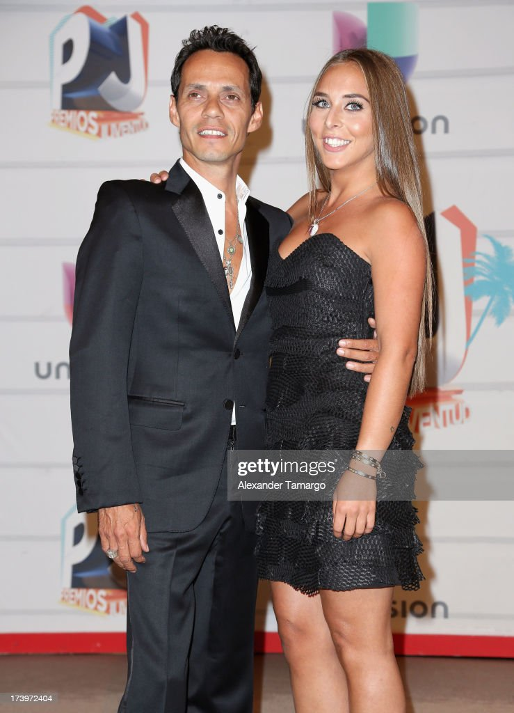 Singer Marc Anthony and Chloe Green attend the Premios Juventud 2013 at Bank United Center on July 18, 2013 in Miami, Florida.