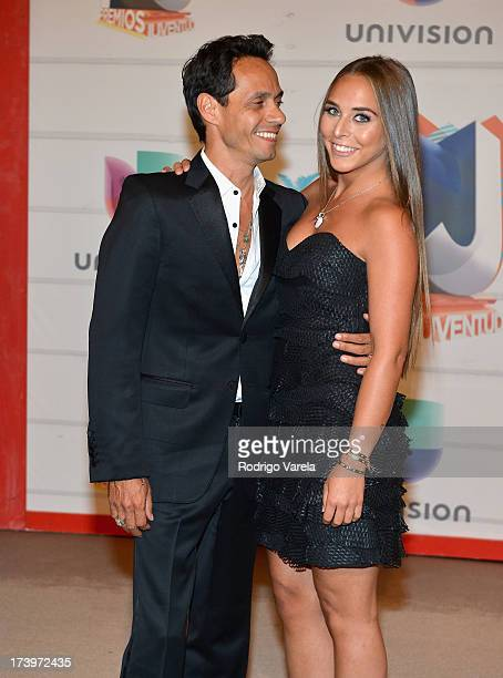Singer Marc Anthony and Chloe Green attend the Premios Juventud 2013 at Bank United Center on July 18 2013 in Miami Florida