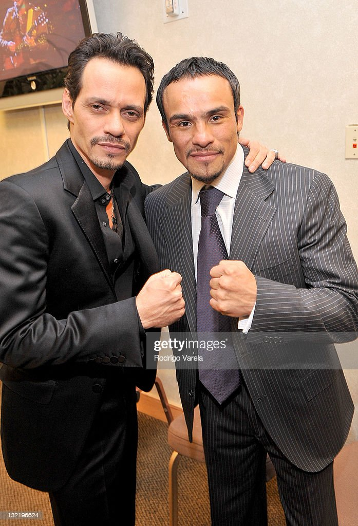 Singer <a gi-track='captionPersonalityLinkClicked' href=/galleries/search?phrase=Marc+Anthony&family=editorial&specificpeople=202544 ng-click='$event.stopPropagation()'>Marc Anthony</a> (L) and professional boxer <a gi-track='captionPersonalityLinkClicked' href=/galleries/search?phrase=Juan+Manuel+Marquez&family=editorial&specificpeople=4202669 ng-click='$event.stopPropagation()'>Juan Manuel Marquez</a> pose backstage at the 12th Annual Latin GRAMMY Awards held at the Mandalay Bay Events Center on November 10, 2011 in Las Vegas, Nevada