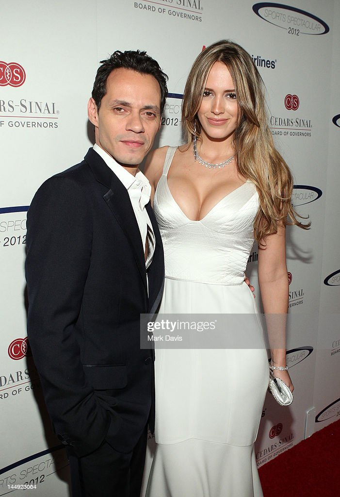 Singer <a gi-track='captionPersonalityLinkClicked' href=/galleries/search?phrase=Marc+Anthony&family=editorial&specificpeople=202544 ng-click='$event.stopPropagation()'>Marc Anthony</a> and Shannon De Lima arrives at the 27th Anniversary Sports Spectacular benefiting Cedars-Sinai Medical Genetics Institute at the Hyatt Regency Century Plaza on May 20, 2012 in Century City, California.