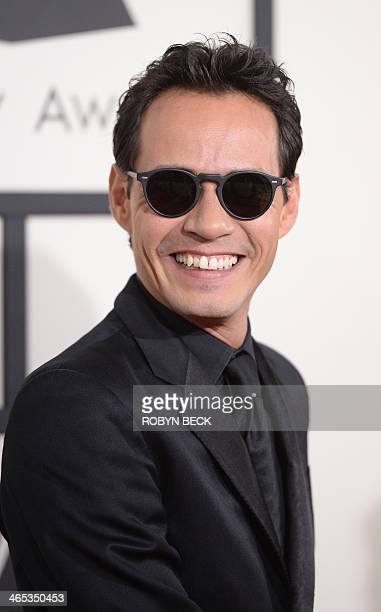 Singer Marc Anthony arrives on the red carpet for the 56th Grammy Awards at the Staples Center in Los Angeles on January 26 2014 AFP PHOTO ROBYN BECK