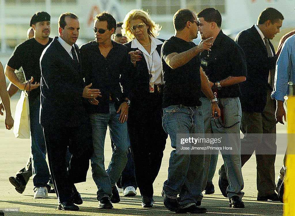 Singer Marc Anthony (2nd-L) speaks with Puerto Rico's Washington Resident Commissioner Anibal Acevedo Vila (L) after Marc Anthony's arrival at Luis Munoz Marin International Airport December 6, 2002 in San Juan, Puerto Rico. Anthony and his wife, former Miss Universe Dayanara Torres, will have their Catholic wedding December 7, 2002 at the Old San Juan Cathedral in San Juan, Puerto Rico.