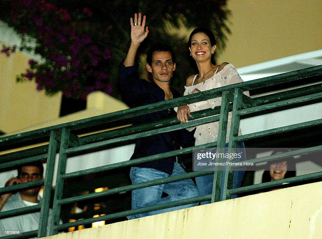 Singer Marc Anthony waves to fans as he stands next to his wife, former Miss Universe Dayanara Torres, while they stand on a balcony at the El Convento Hotel December 6, 2002 in San Juan, Puerto Rico. The couple will have their Catholic wedding December 7, 2002 at the Old San Juan Cathedral in San Juan, Puerto Rico.