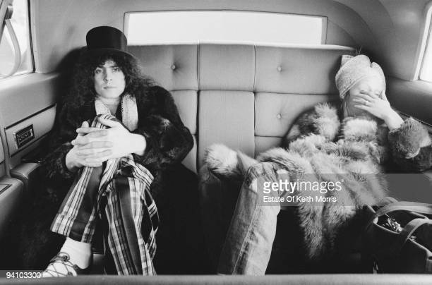 Singer Marc Bolan of English glam rock group TRex in a limousine with his wife June Child during a US tour 1971
